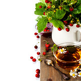 bouquet of wild strawberry with herbal tea and strawberry jam