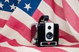 old-fashioned camera on flag