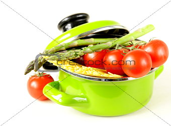 green pot full of vegetables (tomatoes, asparagus, mushrooms, broccoli) and pasta