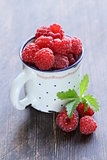 juicy ripe red berry raspberries on wooden background