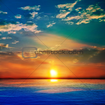 abstract blue nature background with sea unset and clouds