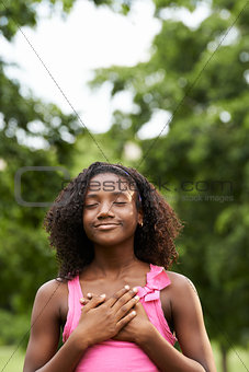Portrait of black girl in love daydreaming and smiling