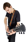 Young man with electric guitar isolated on white background. Per