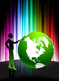 Businesswoman with Globe on Abstract Spectrum Background