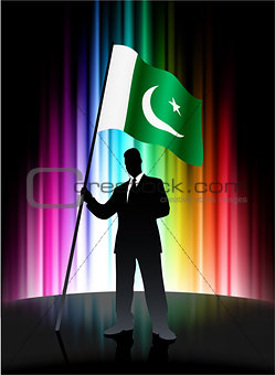 Pakistan Flag with Businessman on Abstract Spectrum Background