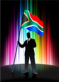 South Africa Flag with Businessman on Abstract Spectrum Backgrou
