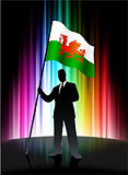 Wales Flag with Businessman on Abstract Spectrum Background