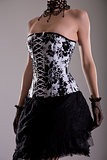 Elegant young woman in black and white corset