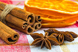 anise stars and cassia cinnamon sticks with dried orange rings