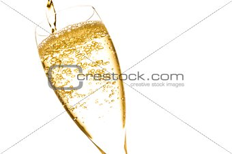 champagne flute with golden fine bubbles