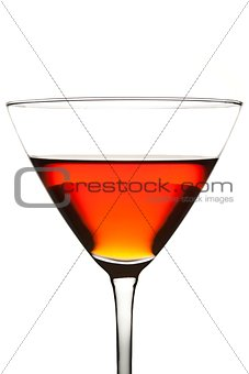 a glass with a red cocktail
