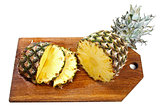 sliced pineapple on wooden board isolated on white