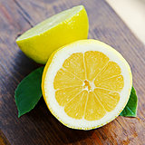 fresh lemon and lime on wooden table