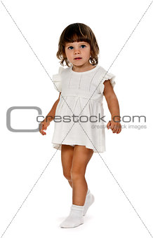 little girl in a knitted dress in the studio