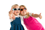 two little girls showing thumbs up
