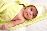 infant wrapped in a towel after bath