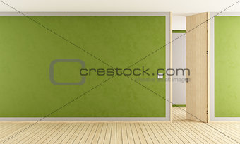 Green living room with open door
