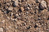 Dry soil and stones of an agricultural field