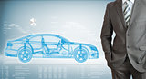 Businessman with high-tech car and graphs