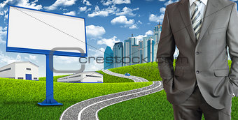 Businessman and urban scene as backdrop