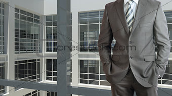 Businessman and large window airport terminal