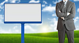 Businessman with blank billboard