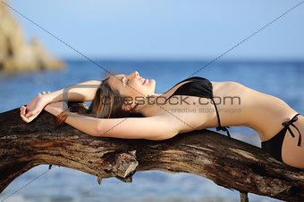 Beautiful woman wearing bikini sunbathing on the beach