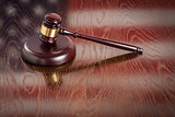 Wooden Gavel Resting on Flag Reflecting Table