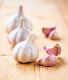 raw garlic on a wooden plank