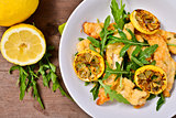 strips of chicken with rocket and lemon