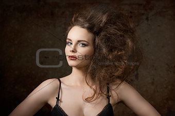 charming girl with voluminous hair