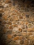 Masonry rock wall lit diagonally