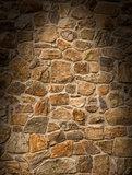 Brown masonry rock wall lit dramatically
