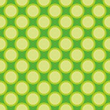 Seamless spring vector pattern with big yellow green polka dots on fresh grass green background.