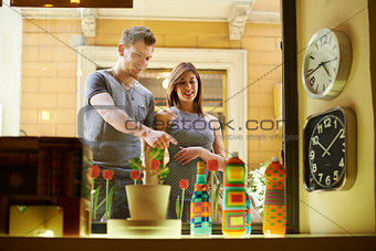 Happy people with couple at window store and shopping