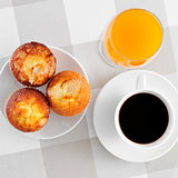 cup of coffee, muffins and orange juice