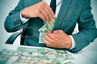 man in suit getting dollar bills in his jacket
