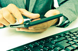 businessman using a tablet in the office, with a retro effect