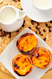 milk and pasteis de nata, typical Portuguese egg tart pastries