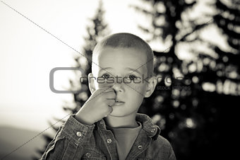 boy picking nose