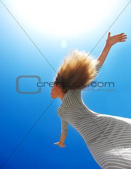 Beautiful female over blue clean sky