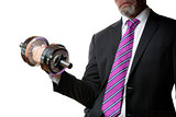 Businessman holding silver dumbbell