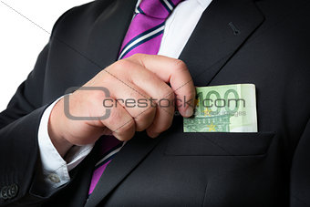 Businessman putting money in pocket
