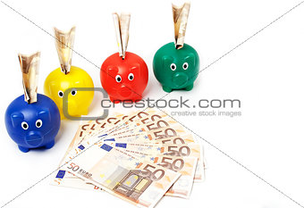 4 piggybanks with euro notes