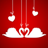 Red background with two white swans and hearts