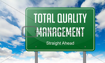 Total Quality Management on Green Highway Signpost.