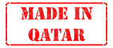 Made in Qatar on Red Rubber Stamp.