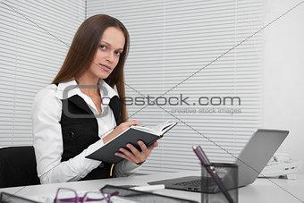 Pretty secretary sitting at desk