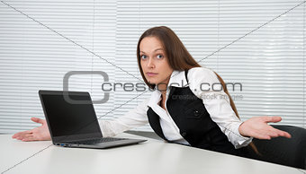Pretty secretary sitting at desk