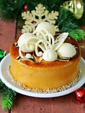festive Christmas cake caramel biscuit  decorated with white chocolate